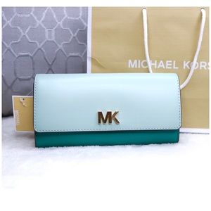 Michael Kors Bags - NWT Michael Kors Montgomery Large Carryall Wallet